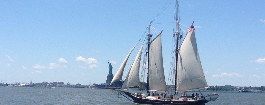 Photo of ship near Statue of Liberty