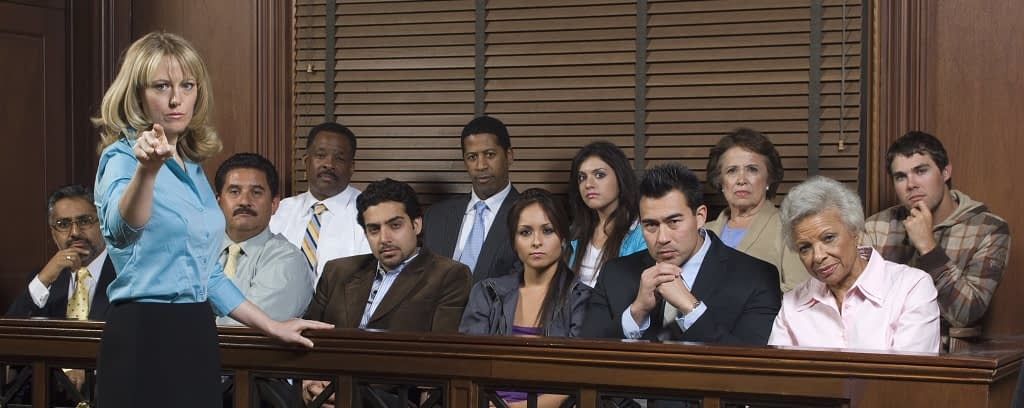 Photo of prosecutor with jury in court