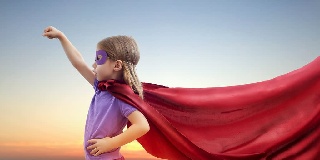Photo of a little girl playing superhero. Be your own superhero.